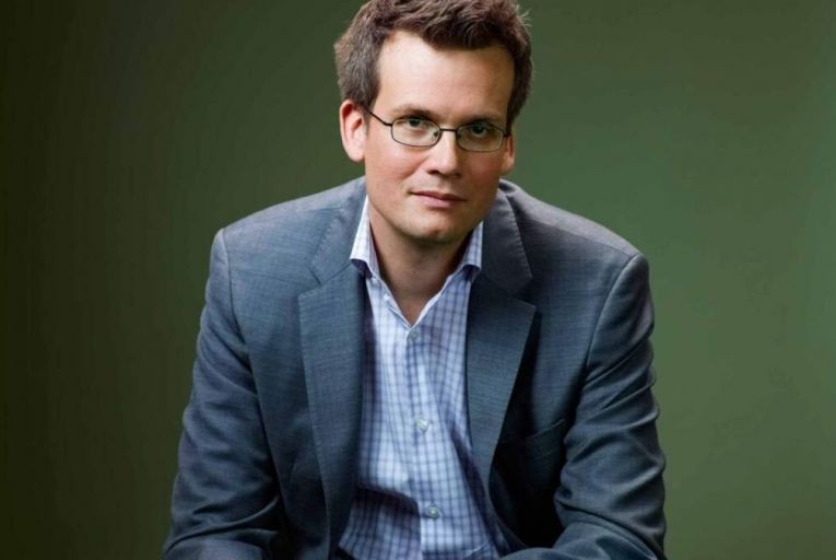 John Green\'s essays originated in podcast form and have a conversational tone
