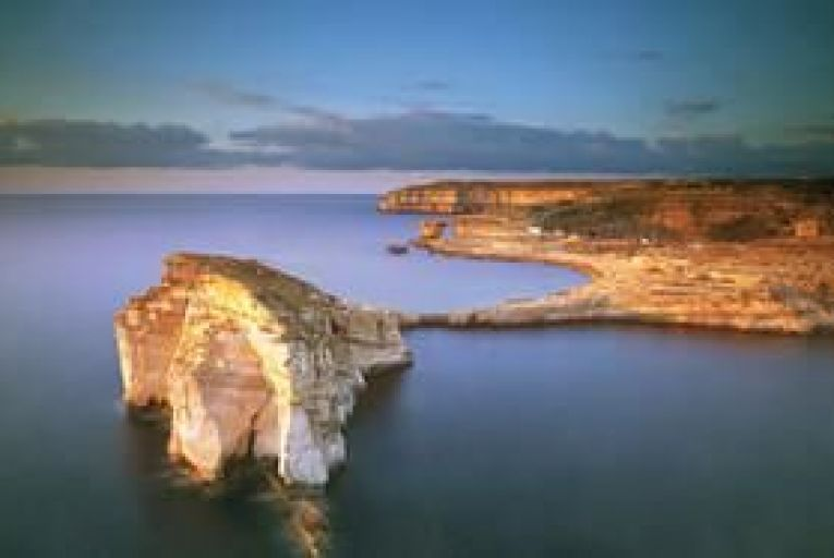 The dramatic scenery of Dwejra Bay attracts tourists to Gozo. Picture: Getty