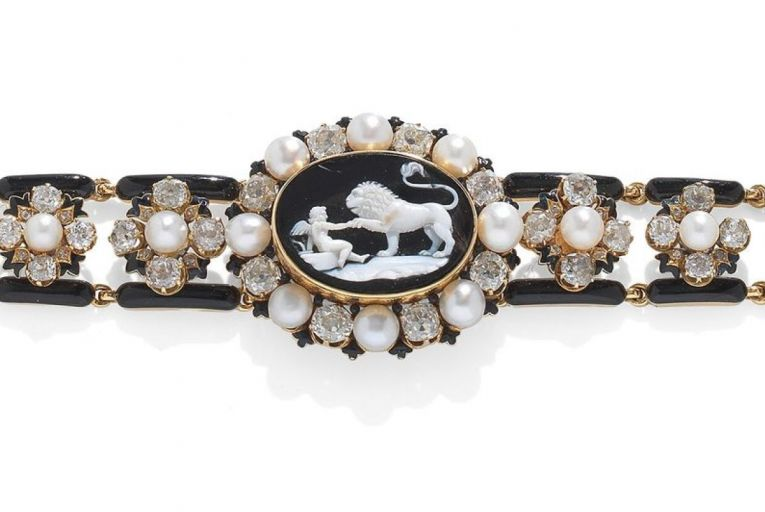 A mid-19th-century onyx cameo, enamel, pearl and diamond bracelet
