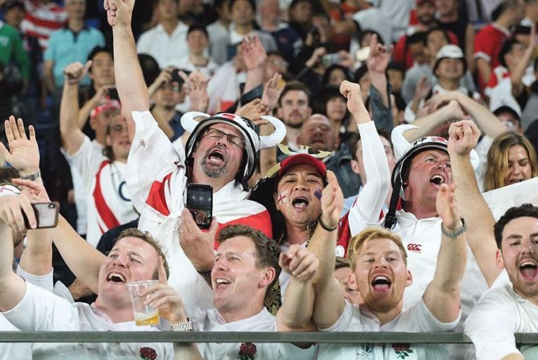 All white on the night: England fans celebrate their side's 19-7 win over New Zealand in Yokohama yesterday Getty