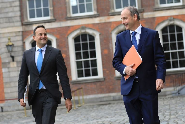 Tánaiste Leo Varadkar and Taoiseach Micheál Martin: their newly formed government faces criticism for topping up the salaries of three super-junior ministers while the country battles to recover from Covid-19