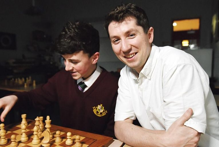 Max Tempany, 15, a chess player and student at Gonzaga College Dublin, with teacher Daniel Lynch Pic: Bryan Meade