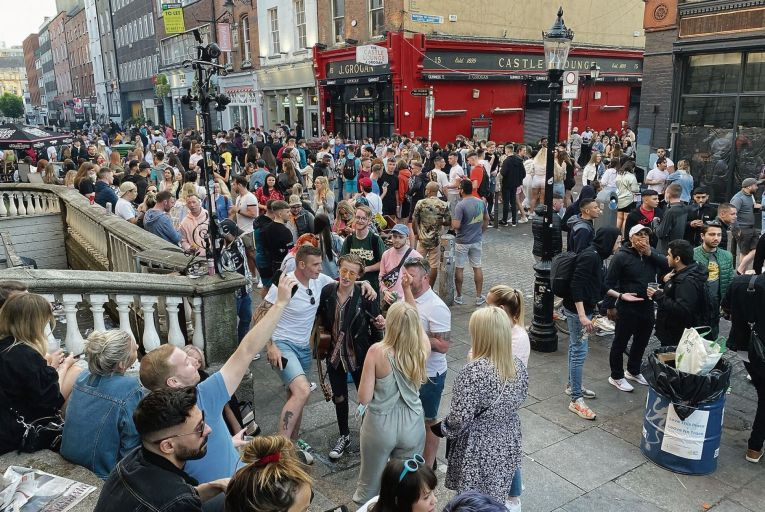 Crowds gather on South William Street in Dublin city centre: one observer suggested counting people in and out of the streets to prevent overcrowding. Picture: PA