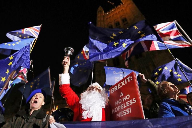 Anti-Brexit activists, one dressed as Santa Claus, protest outside the Houses of Parliament in London last Tuesday