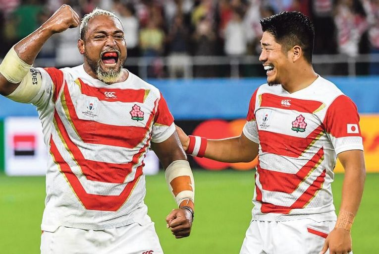 Isileli Nakajima (left), Japan's prop-forward, is all smiles after his team's sensational win over Ireland yesterday in Shizuoka Pic: Getty