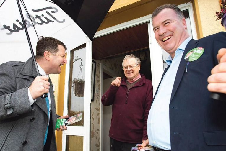 Malcolm Byrne (far left) of Fianna Fáil, canvassing in Campile, Co Wexford Cllr Michael Whelan and local resident Tommy Hayes Picture: Mary Browne