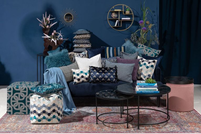 An inky midnight blue looks excellent in multiple textures, on big wall spaces and paired with golds and greens