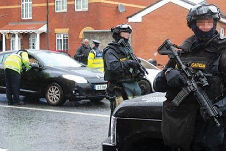 Armed gardaí from the forces Emergency Response Unit  on patrol in north inner city  Dublin in recent days  Picture: Niall Carson/PA