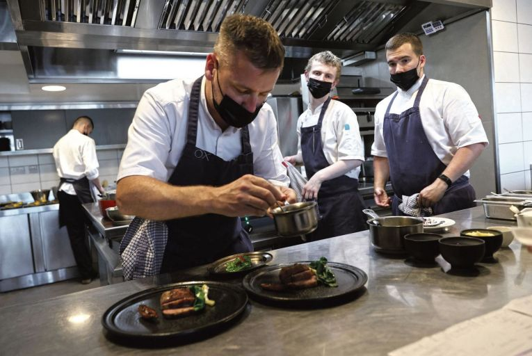 Chef Stephen Toman and his staff in the Michelin-starred Ox restaurant on Belfast's Oxford Street put the finishing touches to a dish. Picture: Stephen Davison/Pacemaker