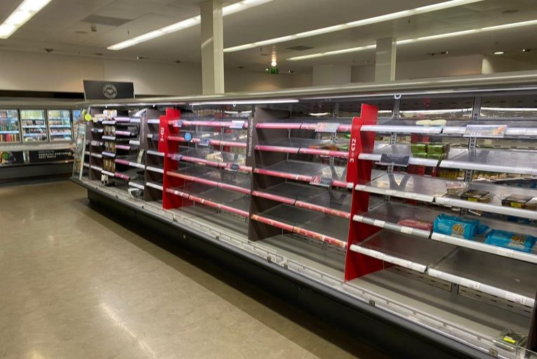 Empty shelves in the refrigerated section of the Marks and Spencer store in Dundrum Town Centre today