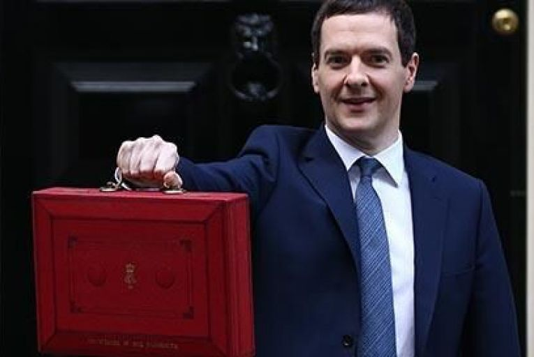 Chancellor of the Exchequer George Osborne holds his ministerial red box up to the media Pic: Getty