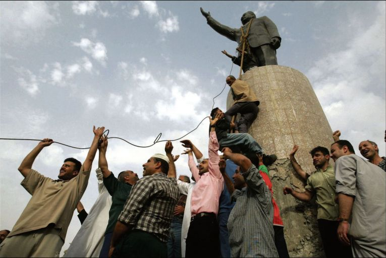 Iraqis celebrate the collapse of Saddam Hussein\'s regime by toppling a statue of him in 2009. Hussein's dictatorship was used to justify the US-led invasion of Iraq. Picture: Getty