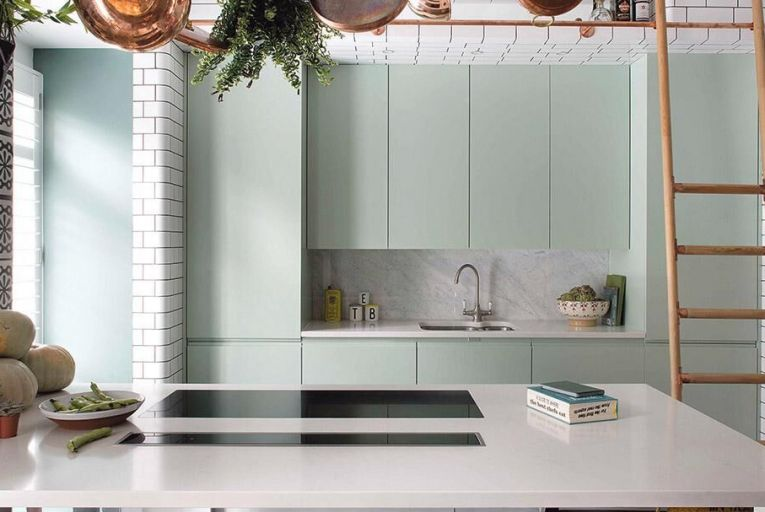 A refurbished kitchen in London offers clean lines and clever storage