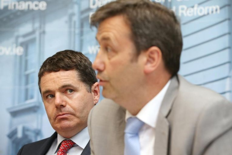 Minister hits out at 'go away' money for compo claimants
