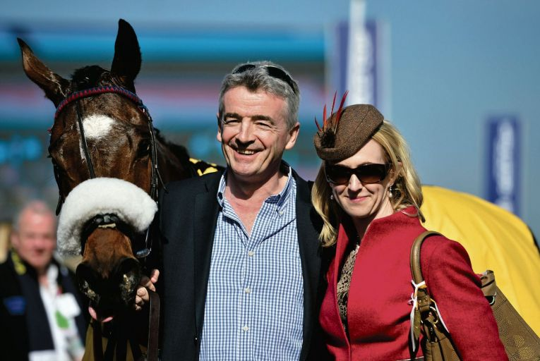 Michael O'Leary, chief executive of Ryanair, and his wife Anita celebrate a win for their racehorse Tiger Roll: the couple were among trustees of the Gigginstown Settlement Charity
