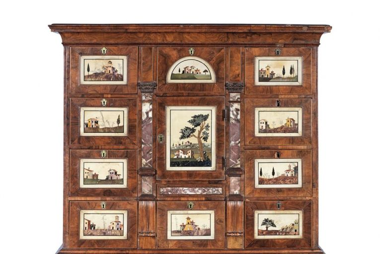 A George II walnut and feather banded bureau cabinet of narrow proportion (£5,000-£7,000)