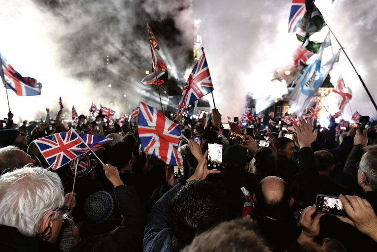 Pro Brexit supporters celebrates as the United Kingdom exits the EU. Credit: Getty