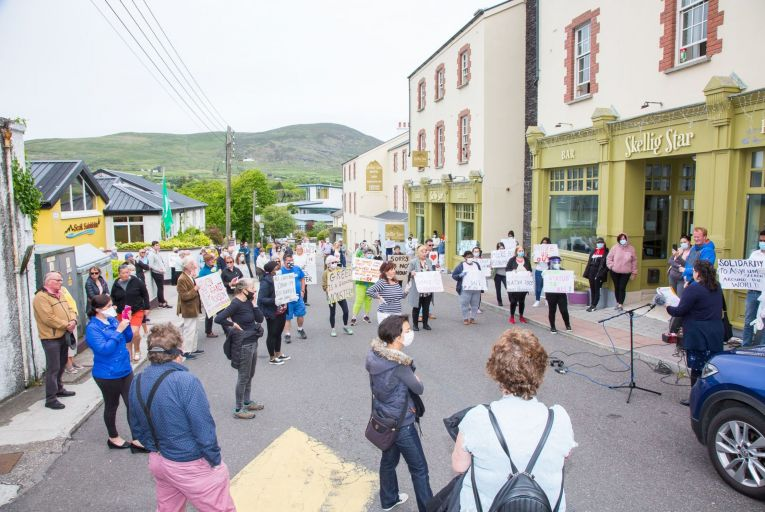 Locals and residents protest together outside the Skelling Star Hotel in Cahersiveen in Co Kerry, calling for the centre to be closed