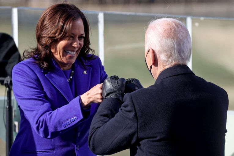 Kamala Harris bumps fists with US President Joe Biden after she was sworn in as the 49th US Vice President yesterday. Picture: Jonathan Ernst/Getty