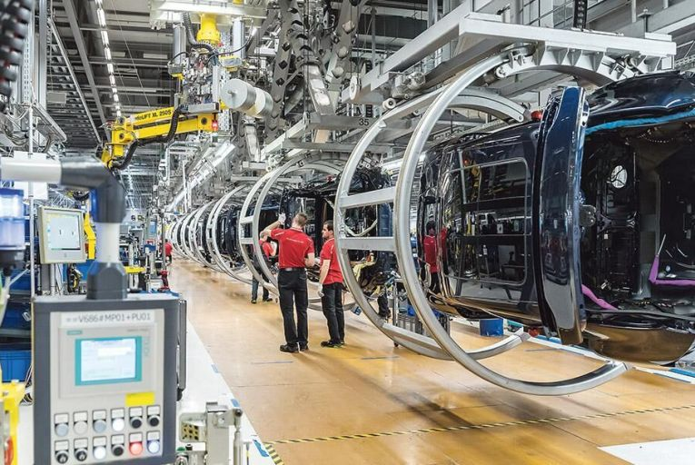 Workers assemble Porsche  Macan and Panamera cars at the Porsche factory in  Leipzig in Germany Picture: Getty