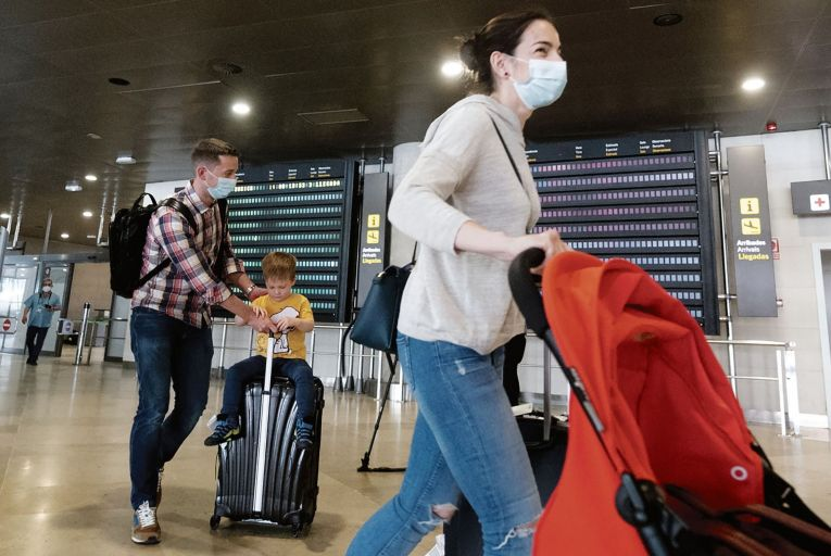 Passengers from Zurich arrive at the airport in Valencia in Spain. Picture: Getty