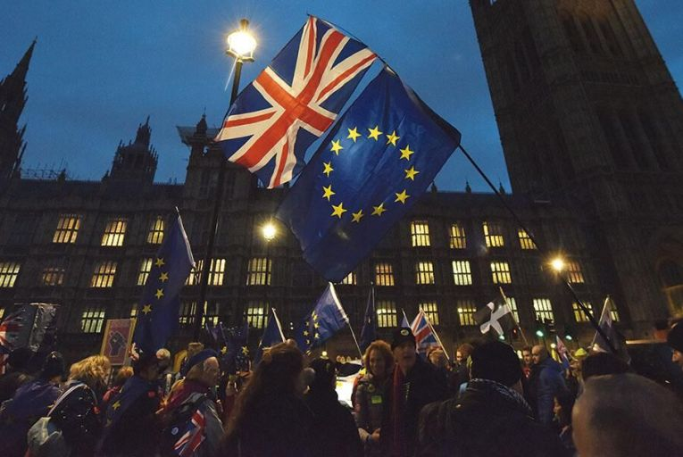 A pro-EU group rallies outside the Houses of Parliament ahead of Tuesday's key voteGetty