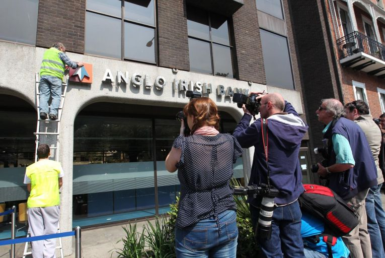 The Anglo Irish Bank sign being removed from its former headquarters in Dublin after it was wound down
