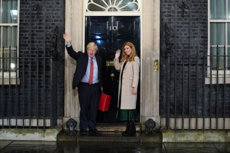 Boris Johnson and his partner Carrie Symonds enter 10 Downing Street this morning. Picture: Getty
