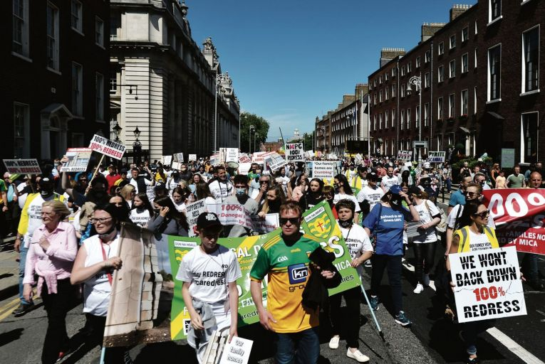 Paddy Diver (centre), mica campaigner and co-founder of '100% Redress No Less' leads thousands of protesters from Co Donegal on a march to Dáil Éireann last month. Picture: Getty