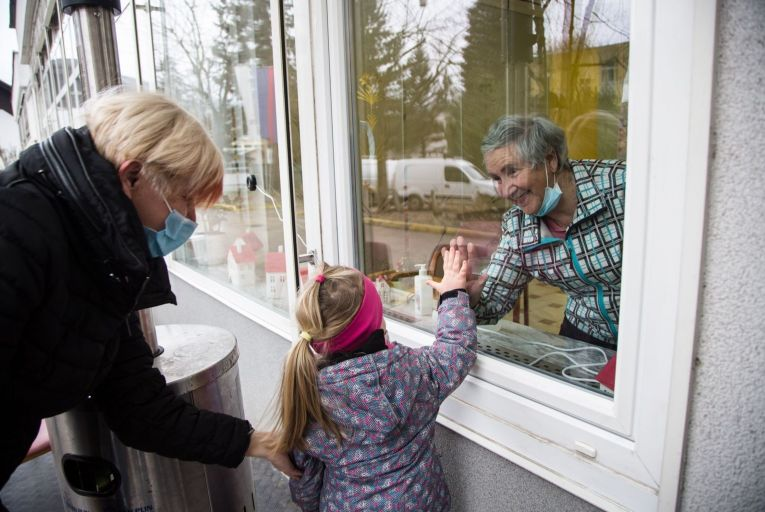 Making contact: a nursing home resident and her granddaughter try to keep in touch on a family visit Picture: Getty