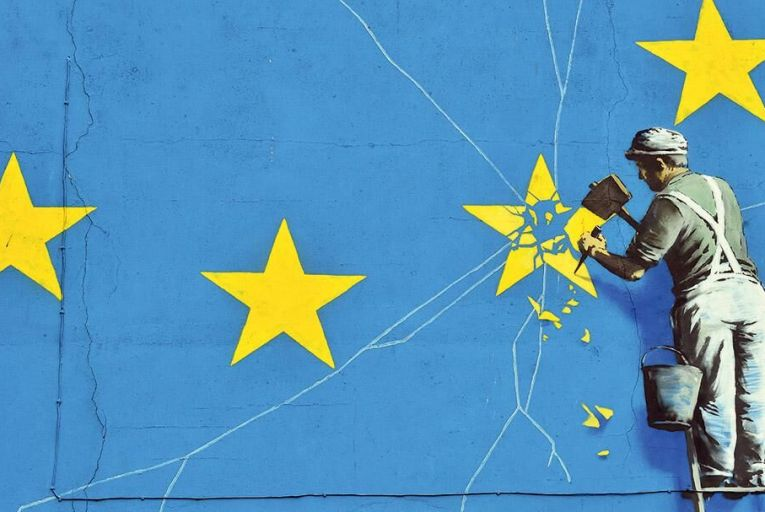 A mural by British artist Banksy, depicting a workman chipping away at one of the stars on a European Union-themed flag, in Dover last week Pic: Getty