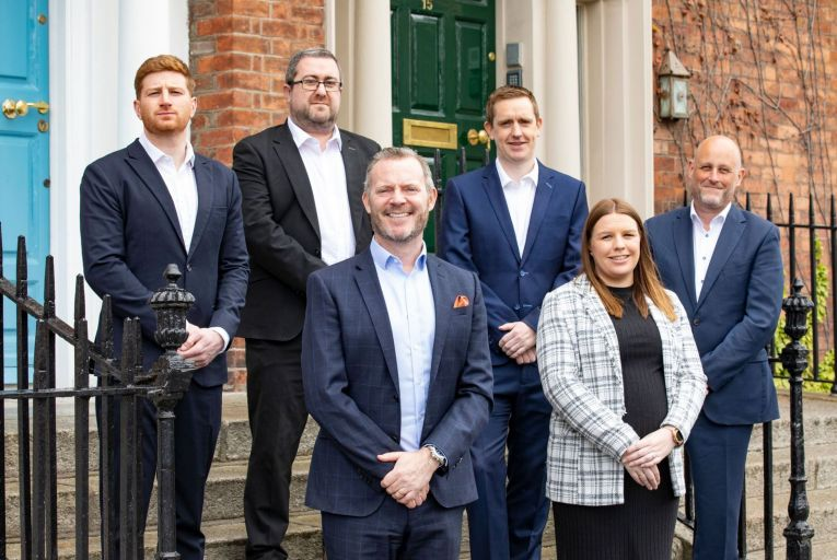 Back row, Stephen Mellon, senior surveyor, David Clancy, director, David O'Malley, divisional director, Jonathan Hillyer, director at QRE, and front row, Conor Whelan, managing director, and Laura Turley, senior surveyor