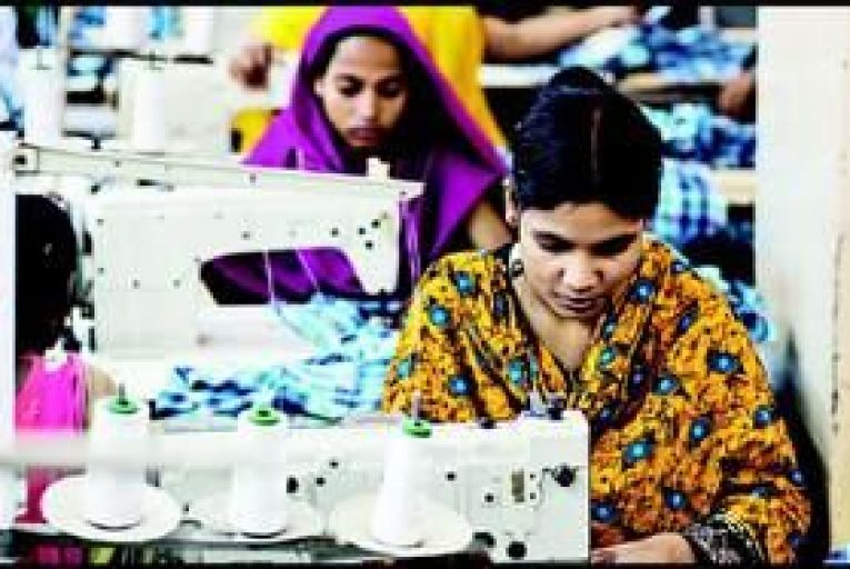 Low-paid workers in a clothes factory in Dhaka, Bangladesh. Photo: Bloomberg