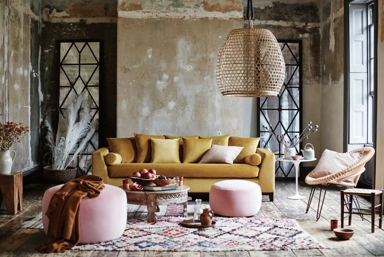 Solitude four-seater sofa in mustard velvet, €909, paired with two Joules Ashwicke round footstools in rose velvet, 259 for the small; €279 for the large stool