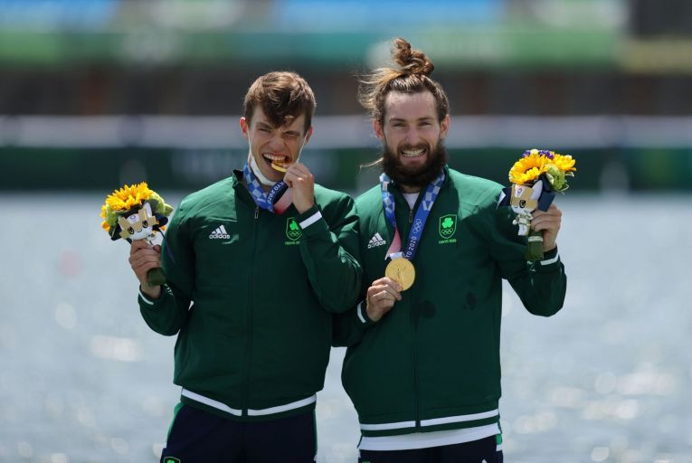 Fintan McCarthy and Paul O\'Donovan celebrate winning Olympic gold in the lightweight double sculls final. Picture: Getty