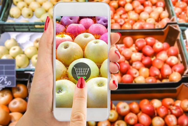 The mobile phone is now an essential shopping tool but only one per cent of grocery shopping is done online. Pic: iStock