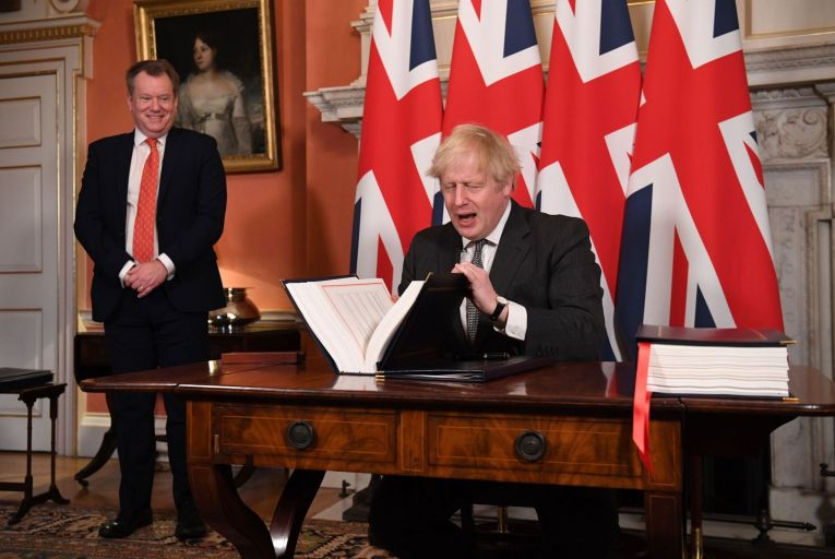 David Frost, the Brexit minister and Boris Johnson  sign the Trade and Cooperation Agreement between the UK and the EU, the Brexit trade deal
