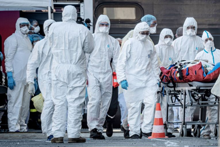 Health workers wearing PPE in Bordeaux, France: A group of supporters of President Emmanuel Macron in France's National Assembly have set up a website called The Day After, asking voters how the country should change as Covid-19 is brought under control'    Getty
