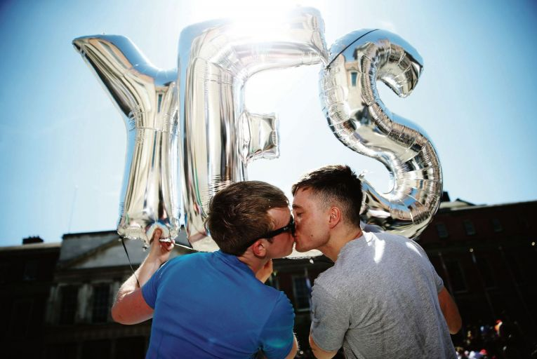 Paul Bonass and Luke Hoare Greene share a kiss at the central count centre in Dublin Castle as they wait for the result of the referendum on same-sex marriage in 2015. Picture: Brian lawless