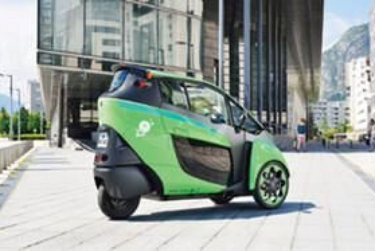The Toyota i-Road can best be described as a cross between a motorbike and a city car.