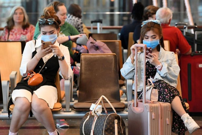Travellers in Changi International Airport in Singapore today. There have been 200,000-plus airline cancellations so far this year. Picture: Roslan Rahman/AFP via Getty
