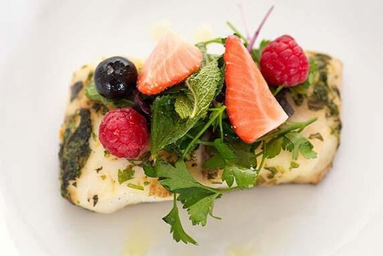 Salty cod with berries