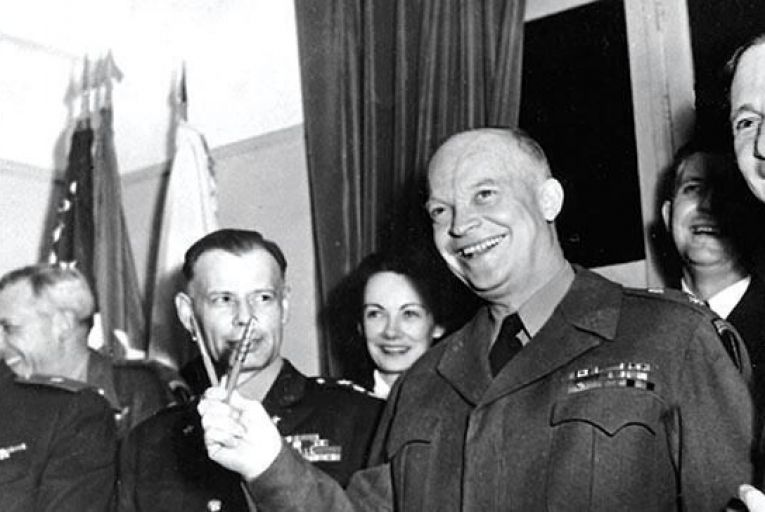 Gen Dwight D Eisenhower makes a V for victory with two pens used for the signing of Germany's unconditional surrender at Reims, France, May 7, 1945. Pictured from far left: Russian Gen Ivan Susloparov; Lt Gen Sir FE Morgan, background; Lt Gen Walter Bedell Smith; Kay Summersby; Gen Eisenhower; Capt Harry C Butcher, background; and Sir Arthur Tedder Picture: AP