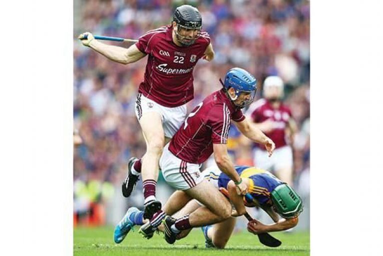 Tipperary\'s Cathal Barrett is tackled by Johnny Coen and David Collins of Galway. Picture: INPHO