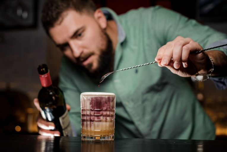 The New York sour combines the elements of a classic whiskey sour with a red wine float on top. Picture: Shutterstock