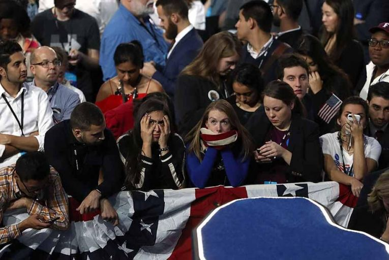 Stunned Hillary Clinton supporters at the Jacob K. Javits Convention Center Pic: Getty