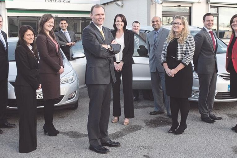 George OConnor (front) of Enterprise Rent-A-Car with members of his team