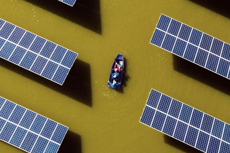 Staff checking photovoltaic power generation facilities in Hai'an city, Jiangsu Province, China. Picture: Getty