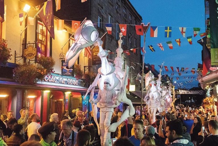 Birdmen roam the streets of Galway during the Galway International Arts Festival