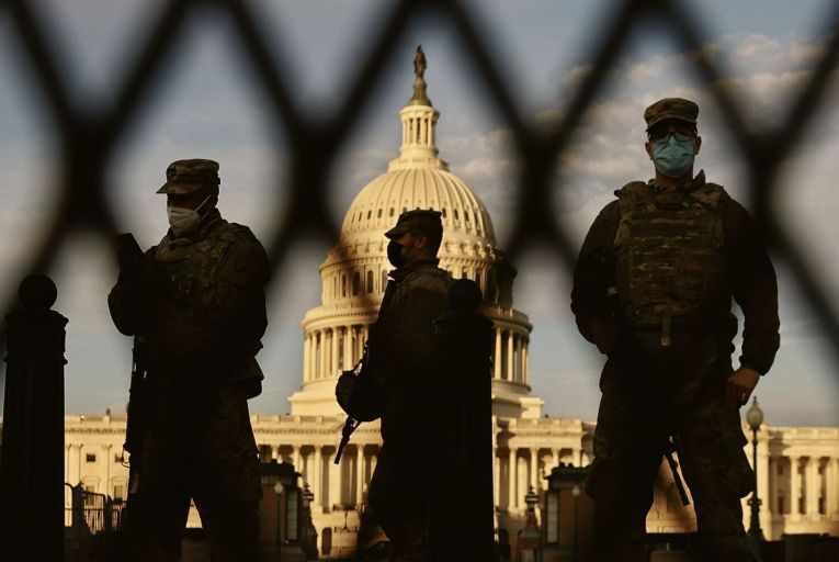 Members of the National Guard stand outside the US Capitol in Washington DC,  two days ahead of Joe Biden's inauguration. Picture: Getty